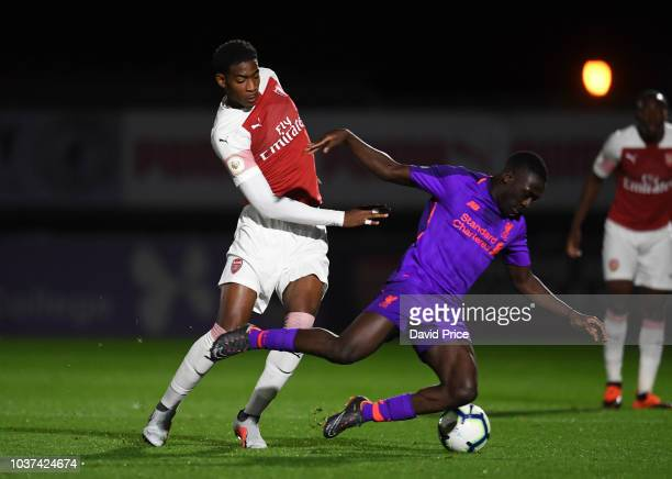 Zech Medley of Arsenal challenges Bobby Adekanye of Liverpool during the match between Arsenal U23 and Liverpool U23 at Meadow Park on September 21...