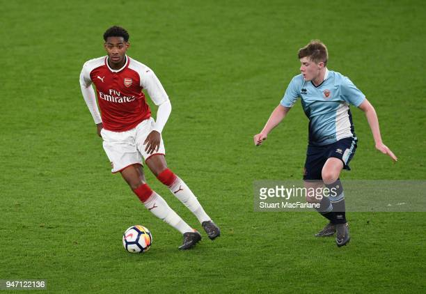 Zech Medley of Arsenal takes on Brendan O'Brien of Blackpool during the FA Youth Cup Semi Final 2nd Leg match between Arsenal and Blackpool at...