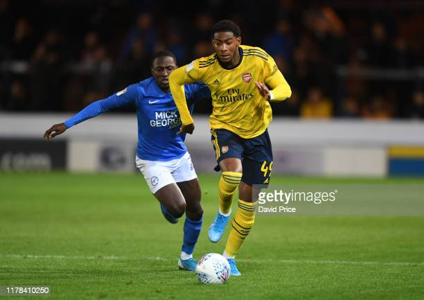 Zech Medley of Arsenal takes on Idris Kanu of Peterborough during the Leasingcom Cup match between Peterborough United and Arsenal U21 at Weston...