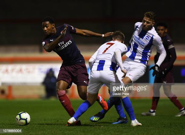 Zech Medley of Arsenal takes on Stefan Ljubicic and Anders Dreyer of Brighton during the match between Brighton Hove Albion v Arsenal during the PL2...