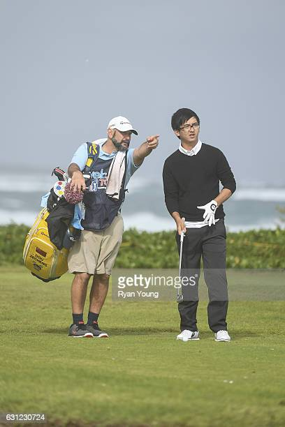 Zecheng Dou and his caddy discuss the tee shot on the 14th hole during the first round of The Bahamas Great Exuma Classic at Sandals Emerald Reef...