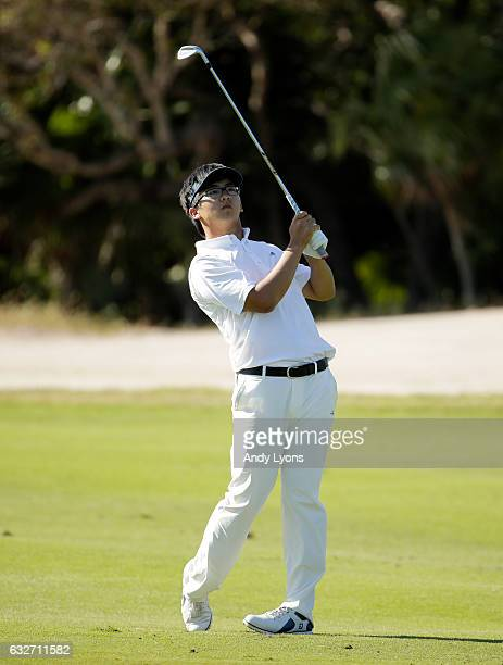 Zecheng Dou of China hits his second shot on the 12th hole during the final round of The Bahamas Great Abaco Classic at the Abaco Club on January 25...