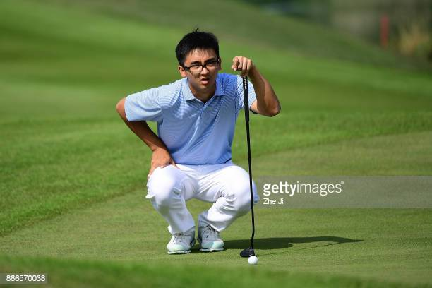 Zecheng Dou of China lines up a putt on the 2nd green during the first round of the WGC HSBC Champions at Sheshan International Golf Club on October...