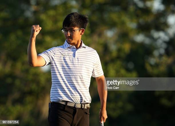 Zecheng Dou of China makes his putt on the 18th green to tie for the lead during the first round of the Zurich Classic at TPC Louisiana on April 26,...