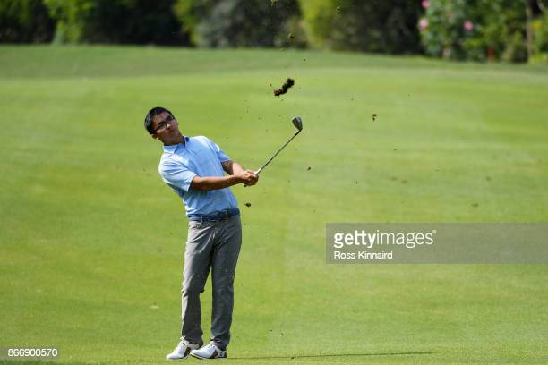Zecheng Dou of China plays a shot on the eighth hole during the second round of the WGC HSBC Champions at Sheshan International Golf Club on October...