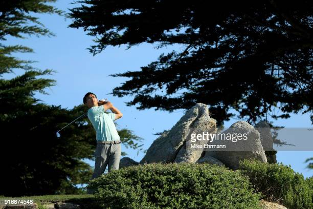 Zecheng Dou of China plays his shot from the 11th tee during Round Three of the ATT Pebble Beach ProAm at Monterey Peninsula Country Club on February...