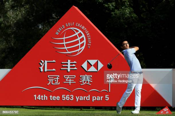 Zecheng Dou of China plays his shot from the 14th tee during the first round of the WGC HSBC Champions at Sheshan International Golf Club on October...