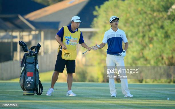 Zecheng Dou of China prepares to hit his second shot on the second hole during the second round of the Webcom Tour Championship held at Atlantic...