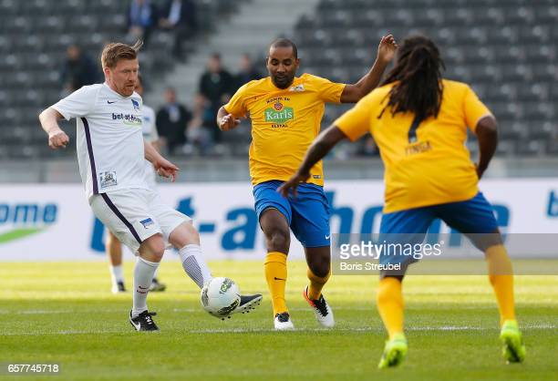 Zecke Neuedorf is challenged by Cacau during the Marcelinho testimonial match between a team of former Hertha BSC players and a team of brasilian...