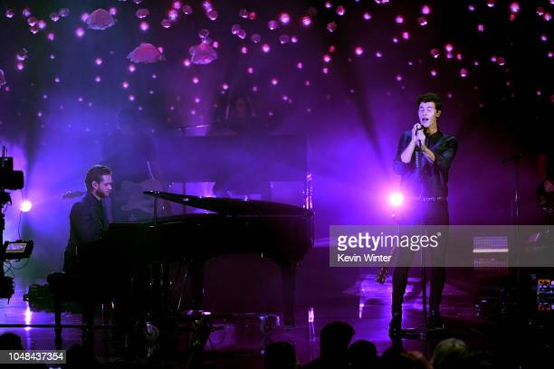Zedd and Shawn Mendes perform onstage during the 2018 American Music Awards at Microsoft Theater on October 9 2018 in Los Angeles California
