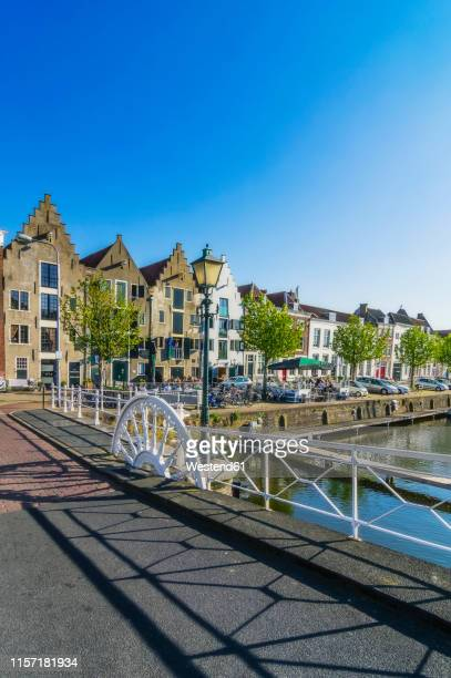 zeeland, middelburg, old town, canal and bridge - middelburg netherlands stock pictures, royalty-free photos & images