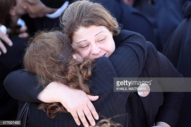 Zeinab the daughter of Iraq's former foreign minister Tareq Aziz is comforted during his funeral on June 13 in the Jordanian city of Madaba some 35...