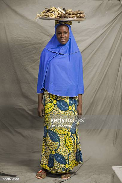 Zeinabou Amadou 15 years old from Niamey in Niger poses during SAFEM Salon international de l'artisanat pour la femme trade fair on December 07 2013...