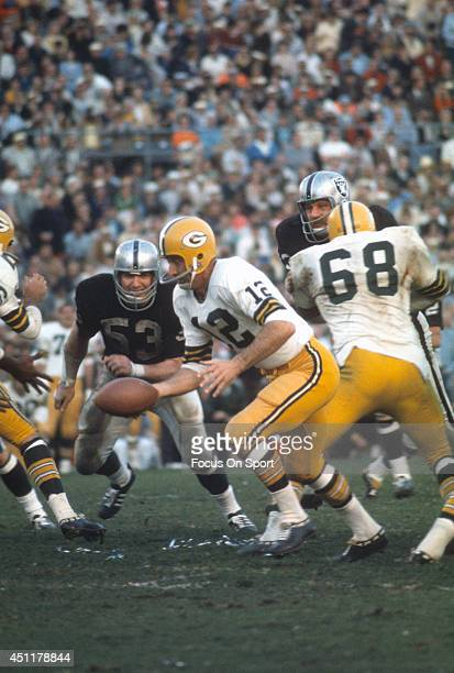 Zeke Bratkowski of the Green Bay Packers turns to hand the ball off to a running back against the Oakland Raiders during Super Bowl II January 14...