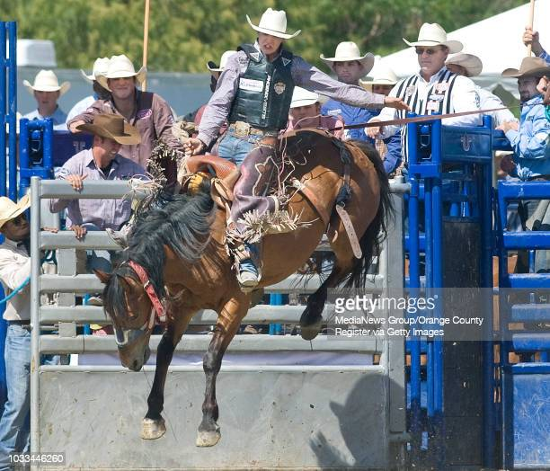 Zeke Thurston hangs on as he competes in the saddle bronc contest during the 15th Annual Rancho Mission Viejo Rodeo on Sunday ///ADDITIONAL INFO...