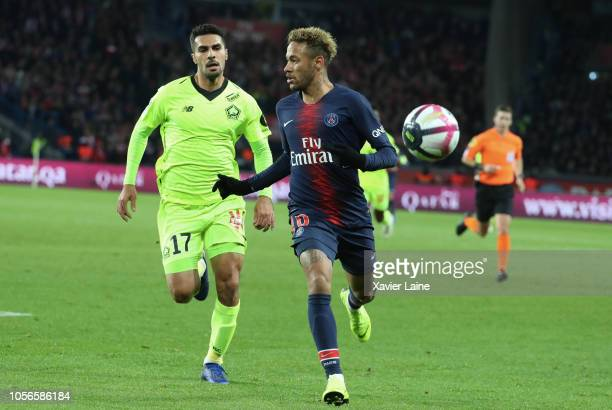 Zeki Celik of Lille OSC in action with Neymar Jr of Paris SaintGermain during the French Ligue 1 match between ParisSaint Germain and Lille OSC at...