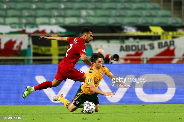 Zeki Çelik of Turkey fights for the ball with Daniel James of Wales during the UEFA Euro 2020 Championship Group A match between Turkey and Wales at...
