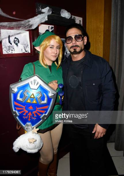 Zelda Williams and Eric Podwall attend Podwall Entertainment's 10th Annual Halloween Party presented by Maker's Mark on October 31 2019 in West...