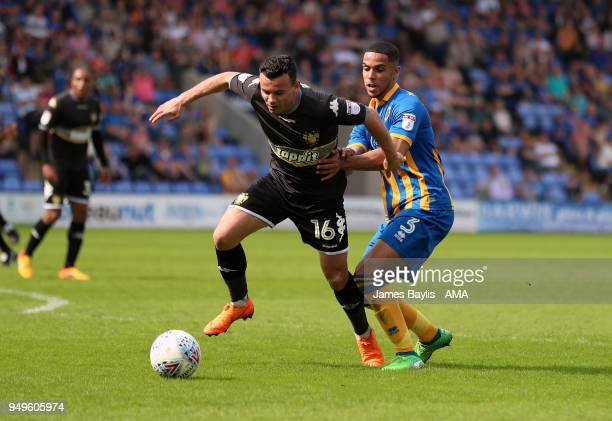 Zeli Ismail of Bury and Max Lowe of Shrewsbury Town during the Sky Bet League One match between Shrewsbury Town and Bury at New Meadow on April 21...