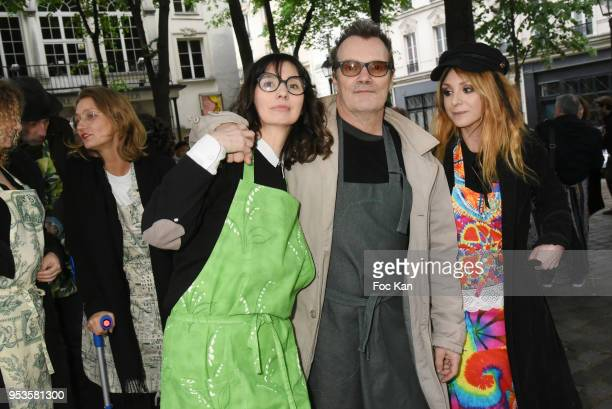 Zelia Van den Bulke, Axel Bauer and painter Erica attend Zelia Van Den Bulke Aprons show At Zelia Abbesses Shop on May 1, 2018 in Paris, France.