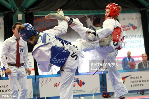 Zeliha Agris of Turkey in action against Vanja Stankovic of Serbia in the women's 49 kg category of the WTE European Taekwondo Championships 2018 at...