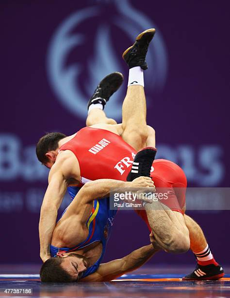Zelimkhan Khadjiev of France and Alberto Martinez Navarro of Spain compete in the Men's Wrestling Freestyle 74kg qualificiation round during day five...