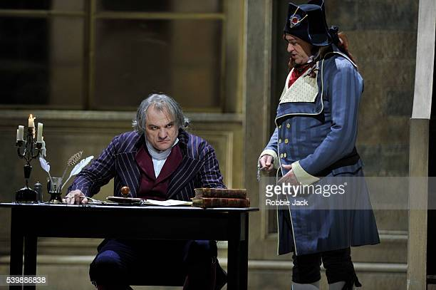 Zeljko Lucic as Carlo Gerard and Carlo Bosi as Un incredibile in the Royal Opera's production of Umberto Giordano's Andrea Chenier directed by David...