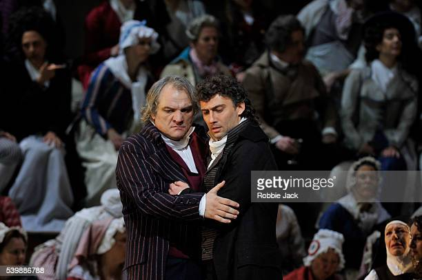 Zeljko Lucic as Carlo Gerard and Jonas Kaufmann as Andrea Chenier with artists of the company in the Royal Opera's production of Umberto Giordano's...