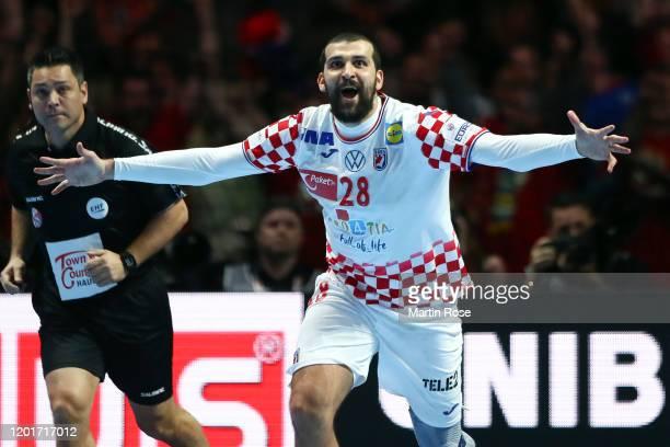Zeljko Musa of Croatia celebrates scoring the winning goal in the second extra time during the Men's EHF EURO 2020 semi final match between Norway...