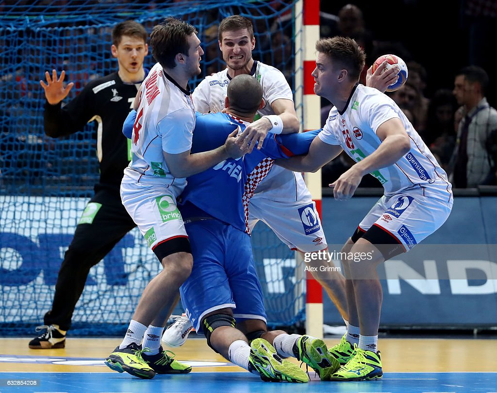 Zeljko Musa (C) of Croatia challenges Christian O'Sullivan (L) and Espen Lie hansen of Norway during the 25th IHF Men's World Championship 2017 Semi Final match between Croatia and Norway at Accorhotels Arena on January 27, 2017 in Paris, France.