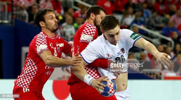 Zeljko Musa of Croatia challenges Stepan Zeman of Czech Republic during the Men's Handball European Championship placement match between Croatia and...