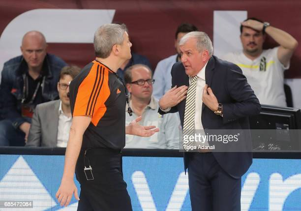 Zeljko Obradovic Head Coach of Fenerbahce Istanbul and refree Luigi Lamonica in action during the Turkish Airlines EuroLeague Final Four Semifinal A...