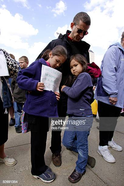 Zell Gaston from West Hartford CT prays with his daughters Eliza and Eva during the Rally for Marriage 2005 for those opposed to Connecticut's...
