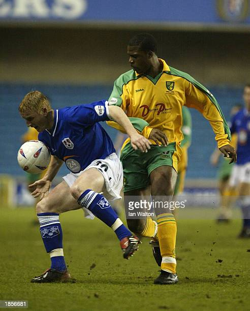Zema Abbey of Norwich tries to tackle Ronnie Bull of Millwall during the Nationwide Division One match between Millwall and Norwich City on March 18...