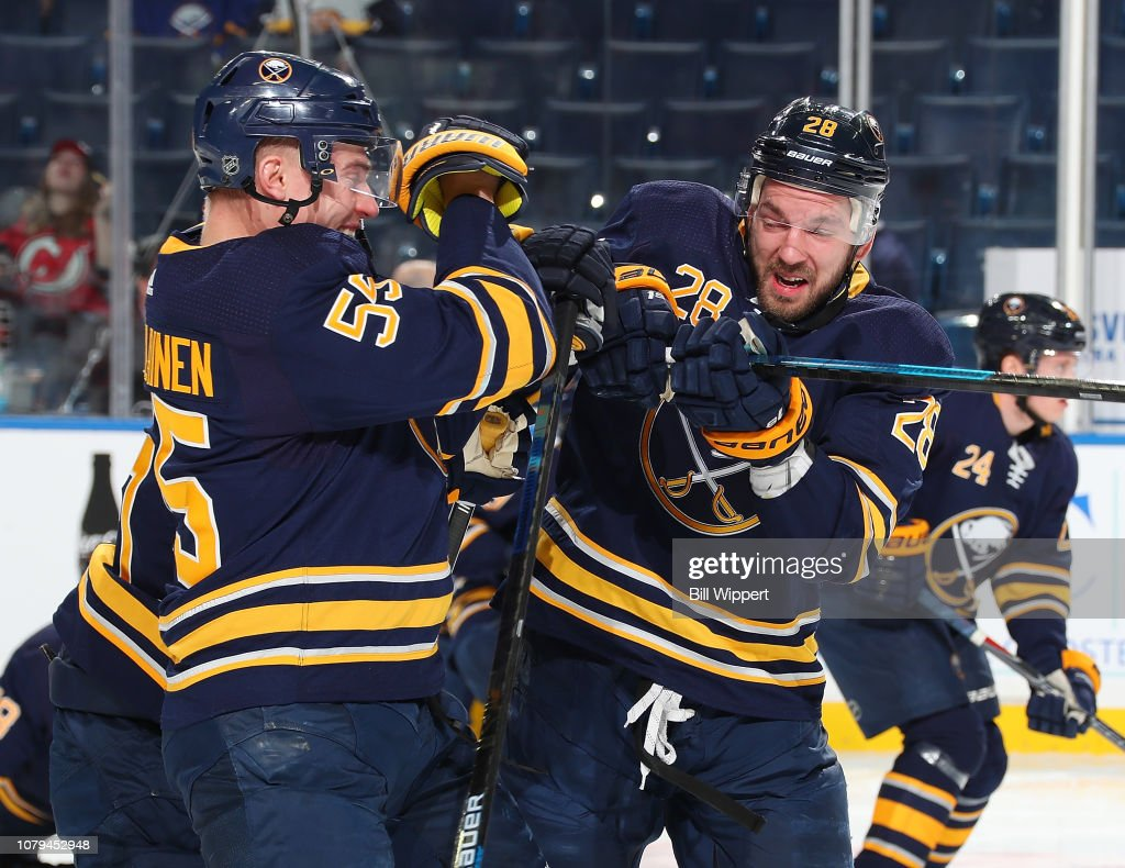 Zemgus Girgensons and Rasmus Ristolainen of the Buffalo Sabres