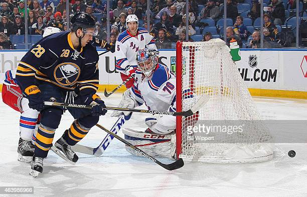 Zemgus Girgensons of the Buffalo Sabres and Mackenzie Skapski of the New York Rangers follow the puck on February 20 2015 at the First Niagara Center...