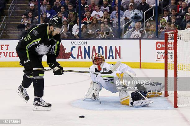 Zemgus Girgensons of the Buffalo Sabres and Team Foligno shoots against Roberto Luongo of the Florida Panthers and Team Toews in the first period...
