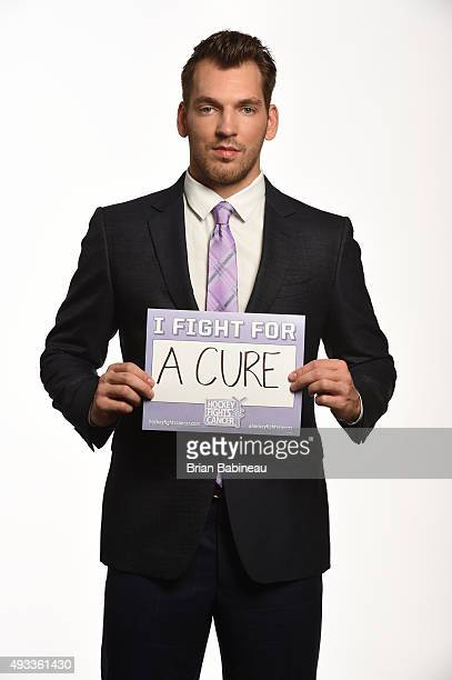 Zemgus Girgensons of the Buffalo Sabres poses for a portrait at the NHL Player Media Tour at the Ritz Carlton on September 8 2015 in Toronto Ontario