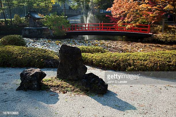 Zen Garden by the Lotus Pond at Garan the sacred complex of temple buildings in Koyasan The pond is crossed by a red bridge with a small island...