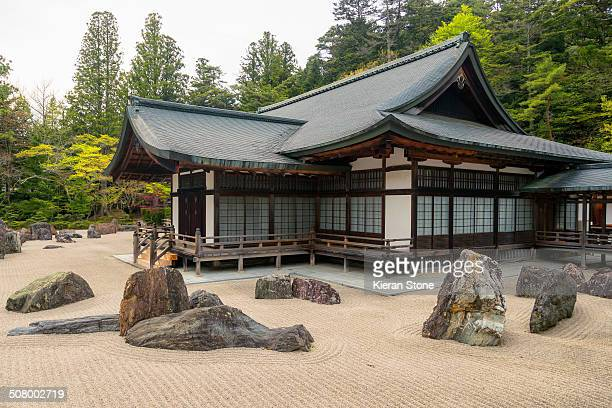 Zen rock garden surrounds a typical Japanese Buddhist monastery building.