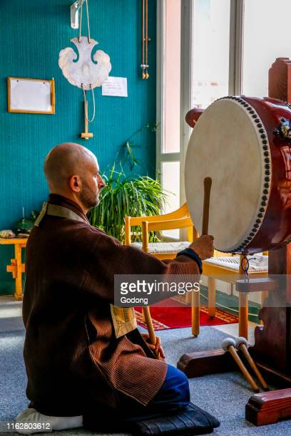 Zen sesshin in Lanau Cantal France Master sounding the drum