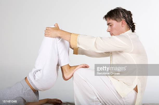 Zen Shiatsu therapist applying massage on a woman