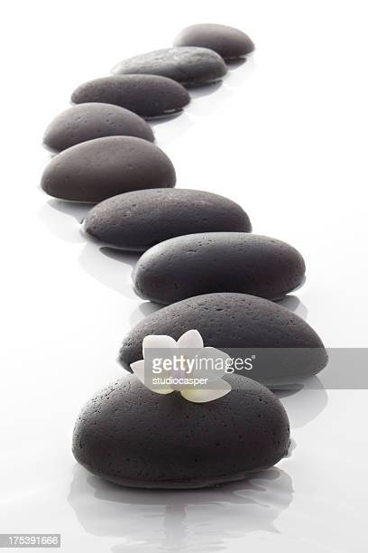 zen / spa stones with flowers - lord bath stock pictures, royalty-free photos & images