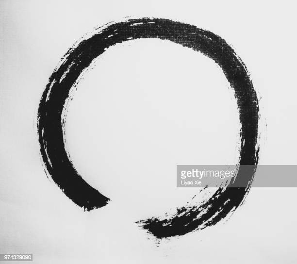 zen symbol-calligraphy - paintbrush stock pictures, royalty-free photos & images