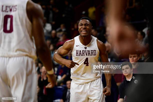 Zena Edosomwan of the Harvard Crimson tries to fire up his team against the Yale Bulldogs during the second half at The Palestra during an Ivy League...