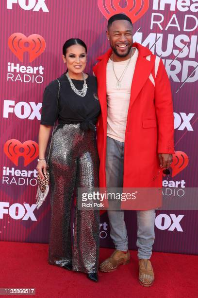 Zena Foster and Tank attends the 2019 iHeartRadio Music Awards which broadcasted live on FOX at Microsoft Theater on March 14 2019 in Los Angeles...