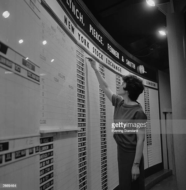 Zena Mander at the quotation board of Merril Lynch Pierce and Fenner Ltd of Fenchurch St in the City of London the UK branch of a big American...
