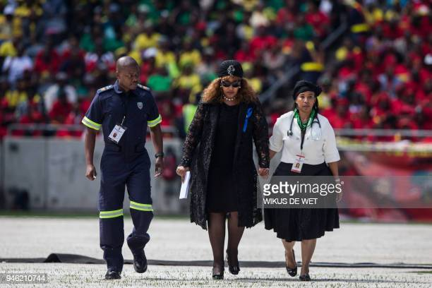 TOPSHOT Zindzi Mandela a daughter of the late antiapartheid icon Winnie MadikizelaMandela is escorted by medical staff after making her speech during...