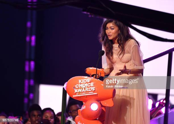 Zendaya accepts the Favorite Movie Actress award for ' SpiderMan Homecoming' and 'The Greatest Showman' onstage at Nickelodeon's 2018 Kids' Choice...