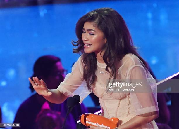 Zendaya accepts the Favorite Movie Actress award for SpiderMan Homecoming and The Greatest Showman on stage at the 31st Annual Nickelodeon Kids'...